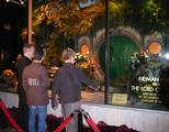 Sir Ian McKellen, Elijah Wood and Billy Boyd inspect the Neiman Marcus Bag End window.